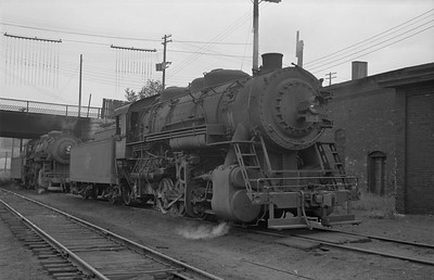 2013.010.CMO.S.0064--bill kuba 6x9 neg--CStPM&O--steam locomotive 0-8-0 M-5 64--St Paul MN--1955 0818