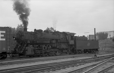 2013.010.CMO.S.0062--bill kuba 6x9 neg--CStPM&O--steam locomotive 0-8-0 M-5 62 switching in yard action--St Paul MN--1955 0818