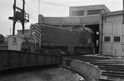 2013.010.MT.D.0104--bill kuba 6x9 neg--MT--Minnesota Transfer ALCO diesel switcher locomotive 104 at roundhouse--Minneapolis MN--1970 0405