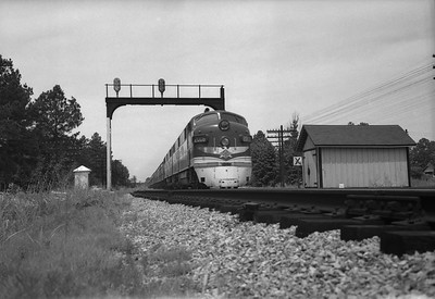 2013.010.TP.D.2006--bill kuba 6x9 neg [RS Plummer]--T&P--EMD diesel locomotive 2006 on passenger train--location unknown--no date