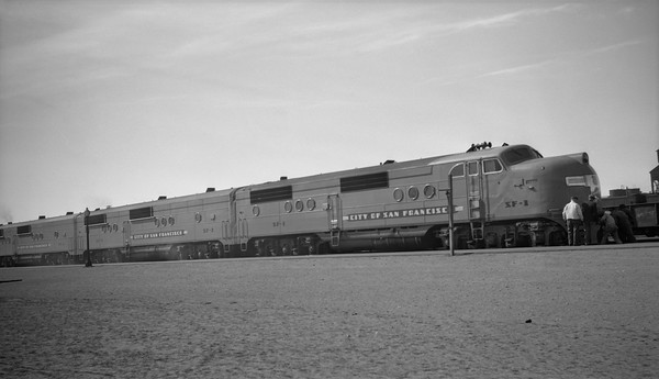 2013.010.UP.D.SF01--bill kuba 6x9 neg--UP--EMC diesel locomotive SF01 on passenger train--Laramie WY--1946 0224