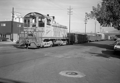 2013.010.UP.D.1081--bill kuba 6x9 neg--UP--diesel switcher locomotive 1081 with freight train street running at 3rd West at 6th Street scene--Salt Lak City UT--1968 1008