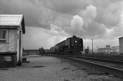 2013.010.UP.AS.0827--bill kuba 6x9 neg--UP--steam locomotive 4-8-4 827 on passenger train in yard scene--Cheyenne WY--1955 0615