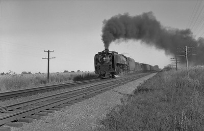 2013.010.UP.AS.0829B--bill kuba 6x9 neg--UP--steam locomotive 4-8-4 829 on freight train action--north of North Bend NE--1958 0927