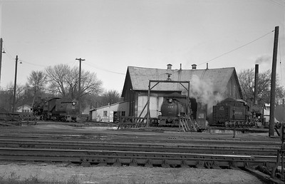 2013.010.UP.AS.0489B--bill kuba 6x9 neg--UP--steam locomotive 2-8-0 480 489 1932 at roundhouse scene--Columbus NE--1955 1105