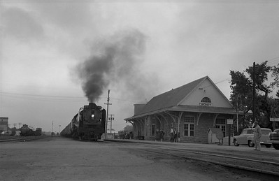 2013.010.UP.AS.0816--bill kuba 6x9 neg--UP--steam locomotive 4-8-4 816 on freight train action passing depot--Sidney NE--1955 0613
