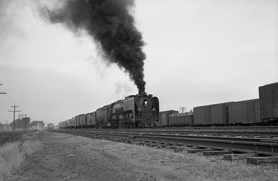 2013.010.UP.AS.0831--bill kuba 6x9 neg--UP--steam locomotive 4-8-4 831 on freight train action--Sidney NE--1955 0613