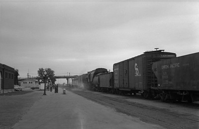 2013.010.UP.AS.0282--bill kuba 6x9 neg--UP--steam locomotive dead in tow in freight train scene--North Platte NE--1955 0613