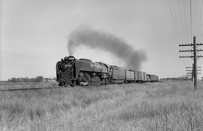 2013.010.UP.AS.0830A--bill kuba 6x9 neg--UP--steam locomotive 4-8-4 830 on freight train action--east of Grand Island NE--1958 1011