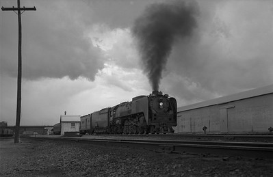 2013.010.UP.AS.0825B--bill kuba 6x9 neg--UP--steam locomotive 4-8-4 825 on passenger train action--Cheyenne WY--1955 0615