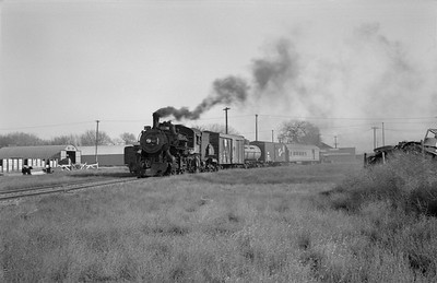 2013.010.UP.AS.0489A--bill kuba 6x9 neg--UP--steam locomotive 2-8-0 489 on mixed freight train action--Columbus NE--1955 1105