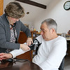 Nurse Kim Trembley from Commonwealth Care Alliance, Inc. works with William Stimpson, 58, at his home in Billerica on Wednesday February 8, 2017. She comes out to visit him at least once a month. SUN/JOHN LOVE
