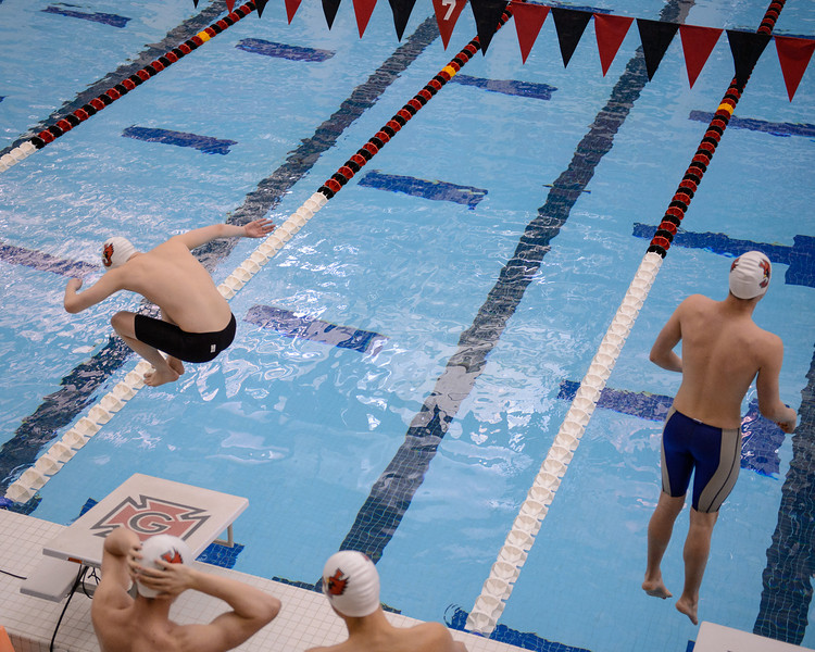 L Aubrey Churchman, R Parker Temple, enter the water for the start of the Men's 400 yd Medley Relay, Friday Night Session