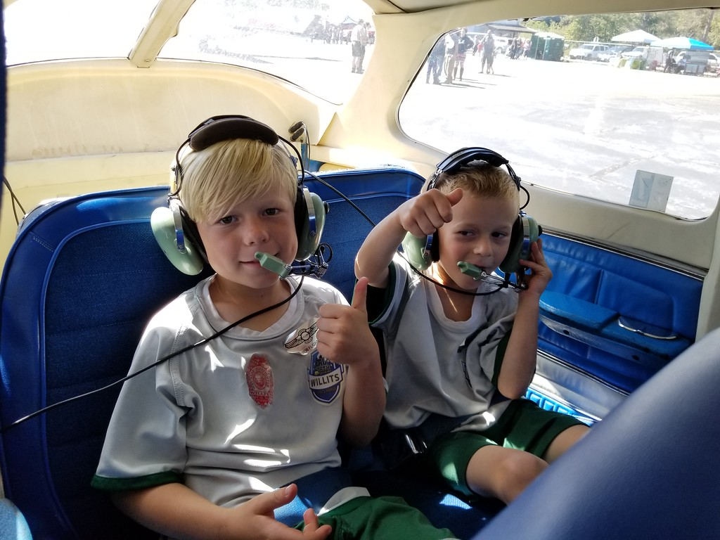 . Brothers Jonas and Jedediah, of Willits, don headsets and get ready for their first ride in a 4-seat Cessna 172. AURA WHITTAKER FOR THE WILLITS NEWS