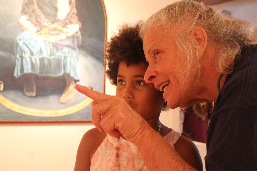 . Amsatou Ndoye (left) gazing at art during Friday night\'s exhibit.