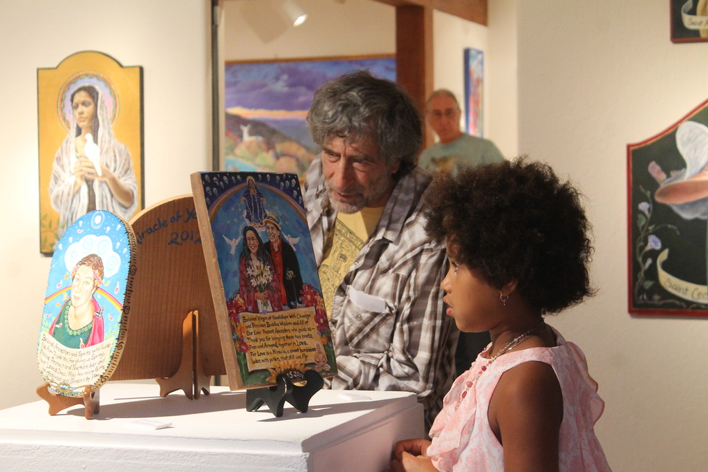 . David Pollin (left) and Amsatou Ndoye at the Willits Center for the Arts on Friday Night.