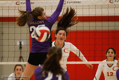 Chico High's Mallorie Tebo watches her spike sail past Willow High's blocker as Chico rallies and pulls ahead to win the second set 31-29 Tuesday September 20, 2016 Chico, Calif. (Emily Bertolino -- Enterprise-Record)