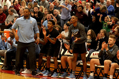 The Willowbrook bench celebrates in the final minutes of a sectional semfinal game win against Naperville North at Glenbard East High School on March 6.