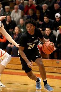 Willowbrook's Matthew Myers (20) drives toward the basket during a sectional semfinal game against Naperville North at Glenbard East High School on March 6.