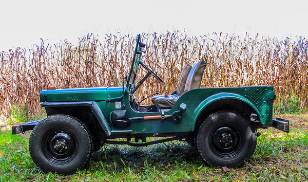 October 2013: With new tires Cooper AT3 with tubes & boots), NOS original wheels all cleaned up and painted,and front end rebuild completed to include; tearing down, prep and painting springs, all new shakels, fittings and hardware things are solid. This early 2a also had the indent on the drivers of the body for a shovel so I decided it only right to add same.