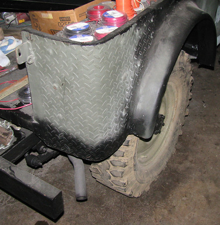 Aug 2011: one of the first things I'm doing to hold this rust bucket together till things start shaping up was to roll on some diamond plate or the rear corners, whick were hanging on by a thread and a prayer (alot of Bondo and spray can camp cover-up). I also added the rear fender flares cause I turned my back one day and dad had run Willy to the back 40, through the biggest mud hole he could find, just to see... He had mud slung up one side and down the other even before I could get the body bolted down to the frame!