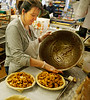 HOLLY PELCZYNSKI - BENNINGTON BANNER Mary Ellen Devlin fills pies with hand cut apples mixed with cinnamon, sugar and other spices  at Willy's Variety Store & Bakery on Wednesday morning in Bennington. Mary Ellen started the baking pies for Willy's eighteen years ago and has become a Thanksgiving tradition. This year she has baked over 150 pies for customers.
