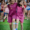 From left, Eleanor Ragsdale, 10, and her sister Vivian, 8, of Wilmington participate in the 3 legged race at the Wilmington 4th of July event. SUN/Caley McGuane