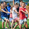 Kids of all ages participate in the tug-of-war event at Wilmington's 4th of July Event. SUN/Caley McGuane