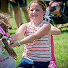 Madison Tucker, 7, of Wilmington pulls with all her might during the tug-of-war competition at the Wilmington 4th of July event. SUN/Caley McGuane