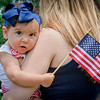 Victoria Smith, 9 months, of Wilmington shows off her Patriotism with her tiny American Flag. SUN/Caley McGuane