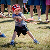 Anthony Cooper, 3, of Wilmington pulls with all his might during the tug-of-war event at the 4th of July Kick off in Wilmington. SUN/Caley McGuane