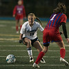 Wilmington High School girls soccer team played Burlington High School at home on Monday night. WHS's Olivia Wingate makes a great move to trick BHS's Madison McDonald and get around her during action in the game. SUN/JOHN LOVE