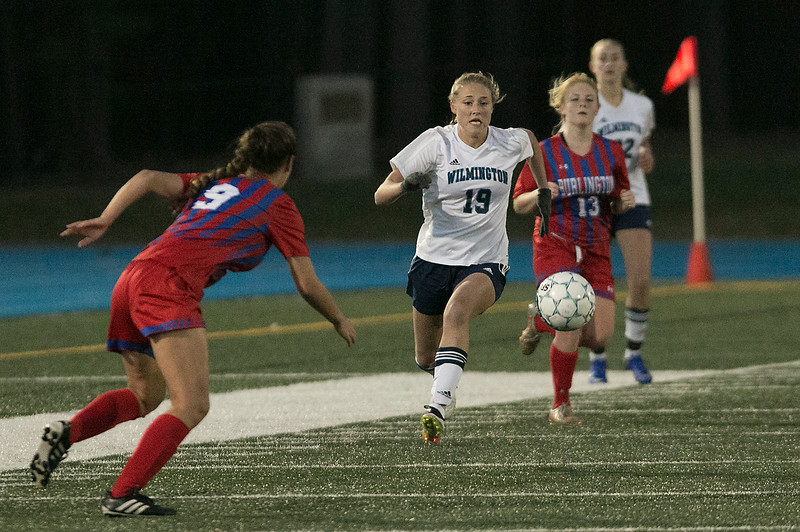 Wilmington High School girls soccer team played Burlington High School at home on Monday night. WHS's Olivia Wingate charges after the ball during action in the game. Looking to get to it first is BHS's #9 Emily Moreira. SUN/JOHN LOVE