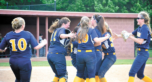 Corey J. Corbin/NEWS<br /> The Wilmington softball team celebrates its 8-7 win over Deer Lakes in the PIAA Class AA playoffs yesterday.
