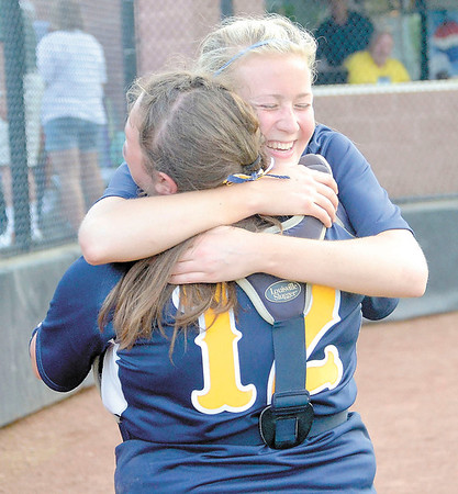 Corey J. Corbin/NEWS<br /> Wilmington seniors Courtney Cohen (12) and Alanna Elliott hug after coming back to beat Deer Lakes 8-7 in the PIAA Class AA playoffs yesterday.