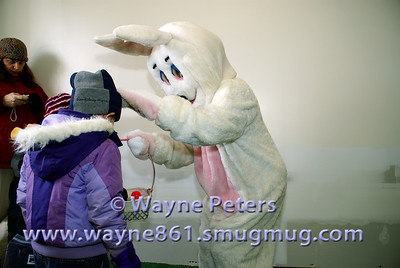 The Easter Bunny greets some children.