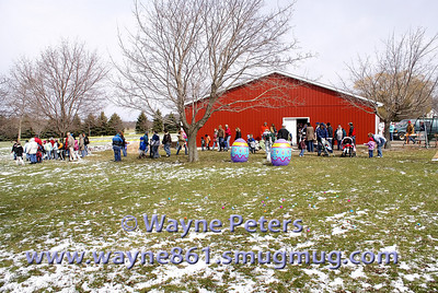 The crowd starts to line up for the egg hunt.