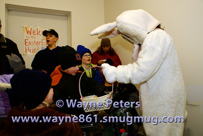 The Easter Bunny hands out candy.