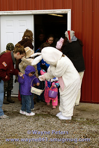 The Easter Bunny gives out some candy.
