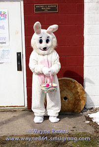 The Easter Bunny waits for the children.
