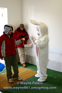 The Easter Bunny hands out some candy.