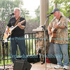 Tom Keefer and Joe Folmar on the porch at Savage at Woodcock, August 11, 2017 in Wilson, NY.