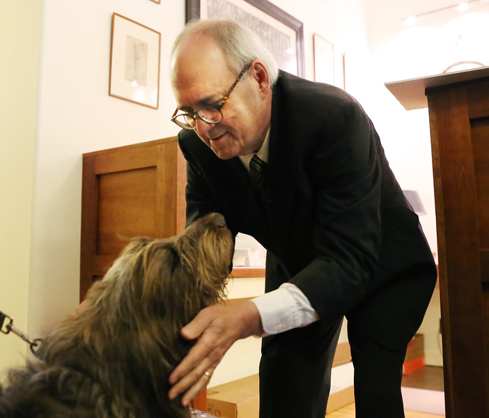 HOLLY PELCZYNSKI - BENNINGTON BANNER Vermont personal injury lawyer Pat Winburn gives his dog Alfie a pet after announcing his running for governor on Wednesday morning at his office in Bennington.