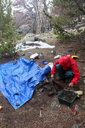 Excavating a prehistoric house structure isn't easy in the snow