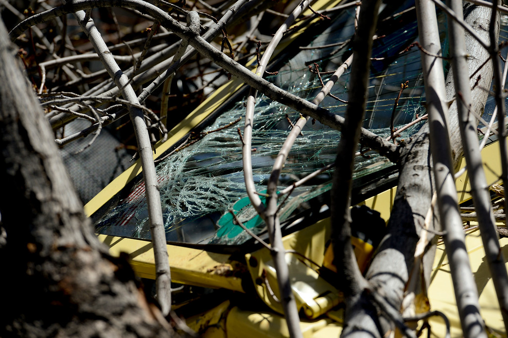 . A Volkswagen convertible is seen crushed under a downed tree on the 400 Block of Highland Avenue in Boulder, Colorado on April 11, 2018. A red flag warning is in effect for Boulder County, signaling increased fire danger due to high temperatures and winds. (Photo by Matthew Jonas/Staff Photographer)