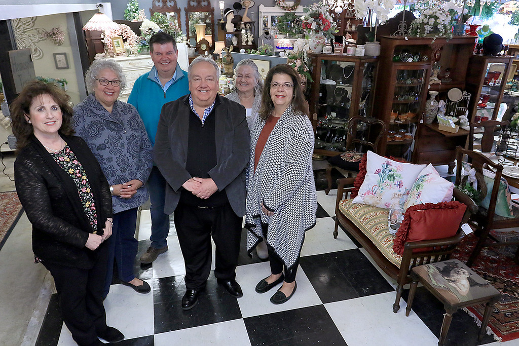 . Windmill Florist & Gifts in Ashby, March 29, 2019. Posing for a picture are the people involved in the shop. From left is helper Maria Legere, vender Charleen Boisvert, buyer Shane Franzen, Owner Ernie Maguy, Clerk Sally Erickson and Vendor Linda Lagoy. Missing from picture is vendor Patty Kennedy. SENTINEL & ENTERPRISE/JOHN LOVE