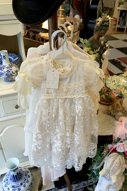 . Windmill Florist & Gifts in Ashby, March 29, 2019. A child\'s dresses with French lace is for sale in the shop. SENTINEL & ENTERPRISE/JOHN LOVE