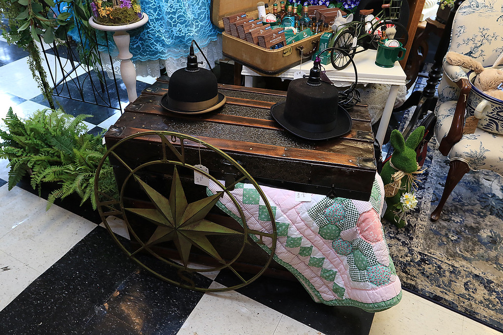 . Windmill Florist & Gifts in Ashby, March 29, 2019. This antique chest, handmade quilt, top hat lights and tin N>E.W.S. piece are all for sale in the shop. SENTINEL & ENTERPRISE/JOHN LOVE