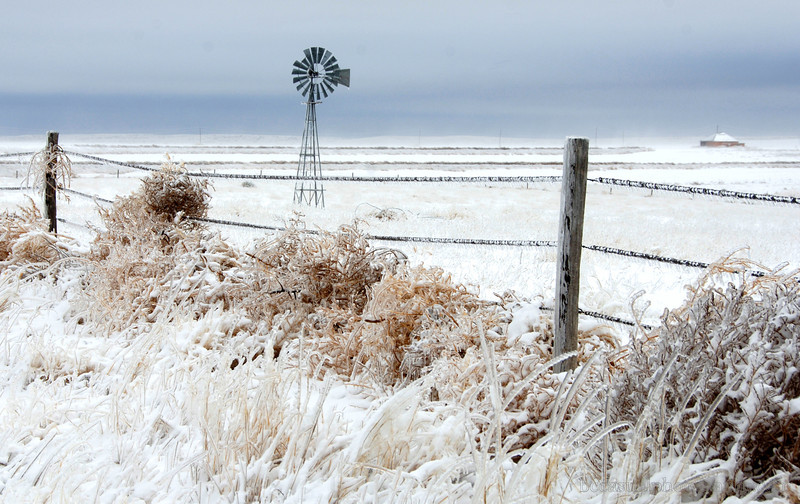 Windmill and Fence in the Snow