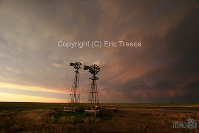 Eastern, CO storm and windmills at sunset.